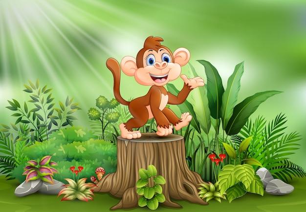 漫画緑の植物と木の切り株に座って猿