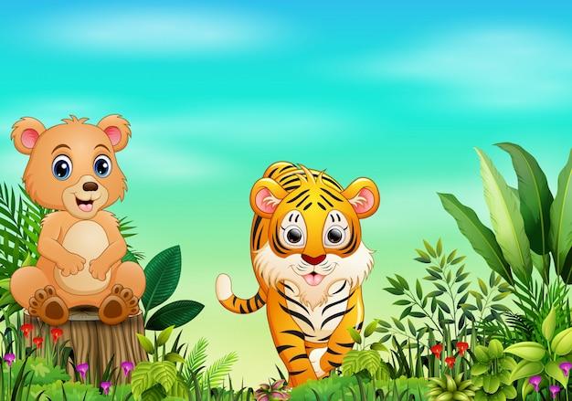 Природа сцена с медведем, сидя на пне и тигре
