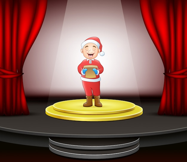 サークルの現代ステージに立っているクリスマスキャロルを歌う男