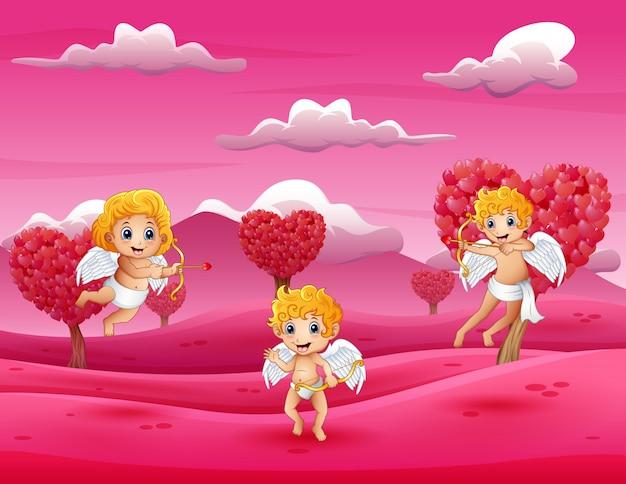 ピンクの野原で遊ぶ漫画キューピッド