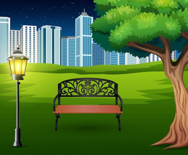 街の建物の背景を持つ緑豊かな公園で椅子の漫画