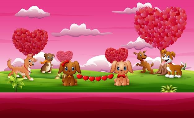 ピンクの庭でバレンタインデー犬のお祝いのグループ