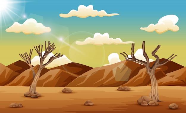 乾いた木と山の砂漠の風景