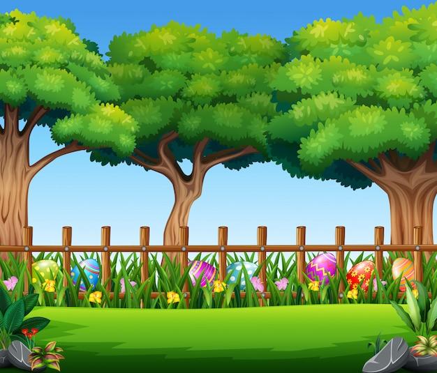 大きな木とハッピーイースターエッグ、自然の背景