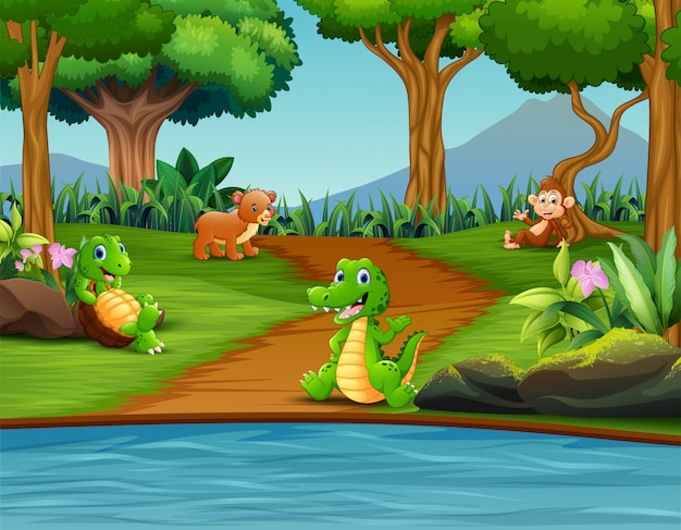 Счастливые разные животные наслаждаются у реки