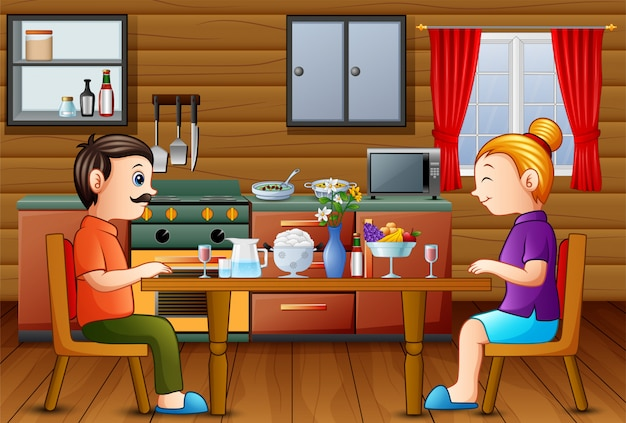 お母さんお父さんと台所のテーブルで家族の夕食