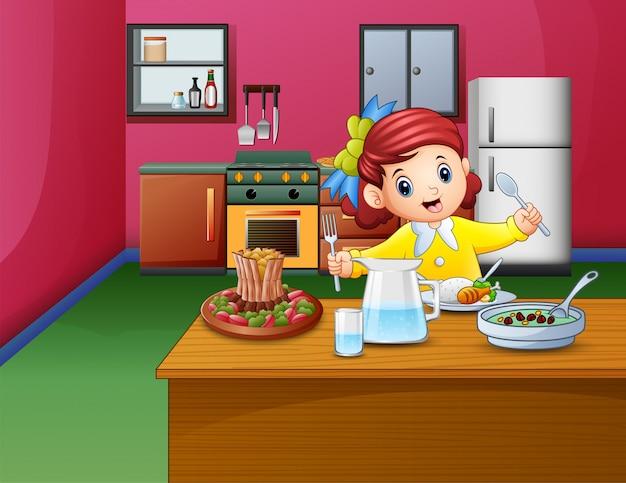 小さな女の子は、ダイニングテーブルに座って食べる