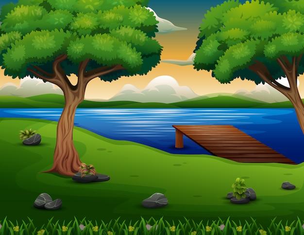 湖の背景に木製の桟橋で自然シーン