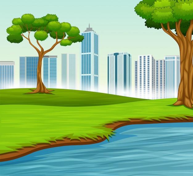 Зеленый пейзаж с деревьями река и город
