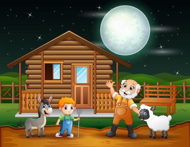 夜に農場で農家と農場の動物
