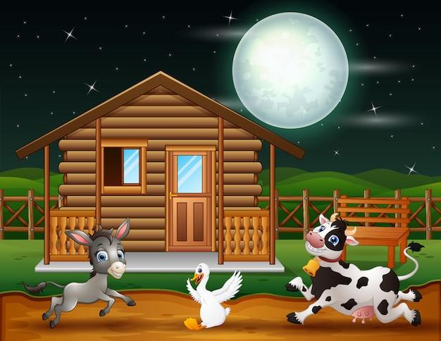 夜のシーンで遊ぶ農場の動物