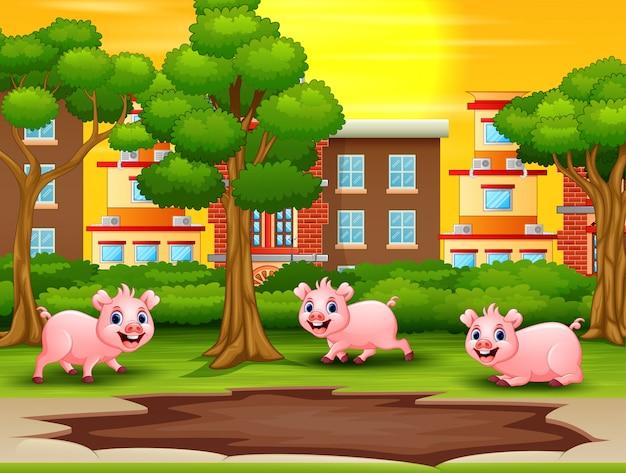 泥の水たまりを見て、遊びたい幸せな豚