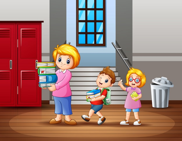 子供たちは先生が本を運ぶのを手伝います