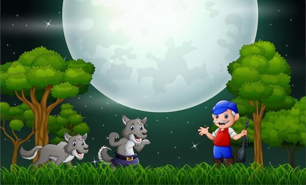 夜の森の中のオオカミを持つ老人