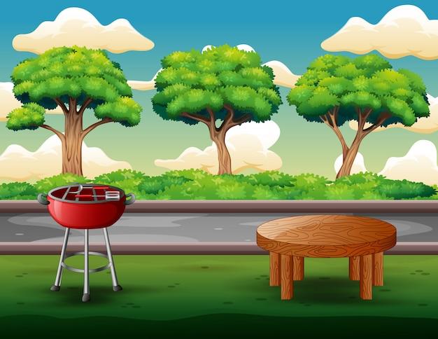 屋外バーベキューパーティーの背景にグリルとテーブル