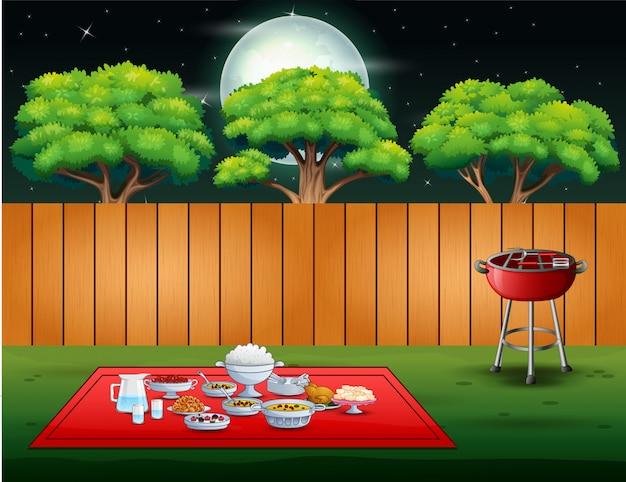 夜のシーンで裏庭のバーベキューパーティー