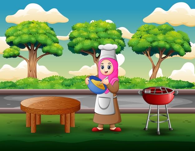 女性が生地になり屋外で料理