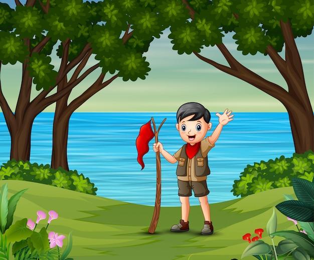 フラグを保持しているスカウト少年と夏の風景