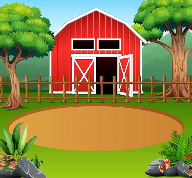 Ферма пейзаж с красным сараем посреди природы