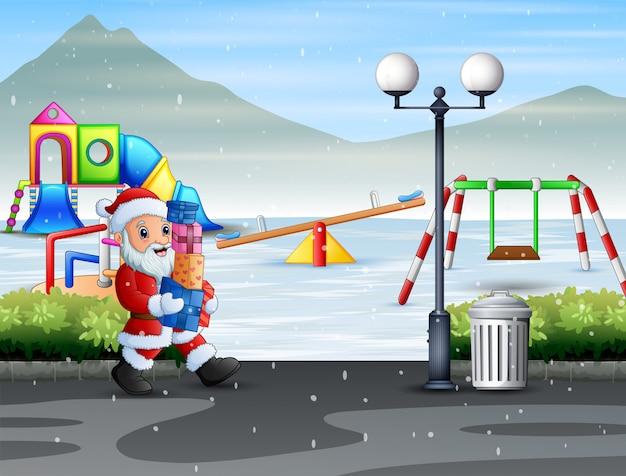 Дед мороз держит подарочные коробки для детей