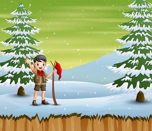 Исследователь мальчик с красным флагом стоял в зимний пейзаж