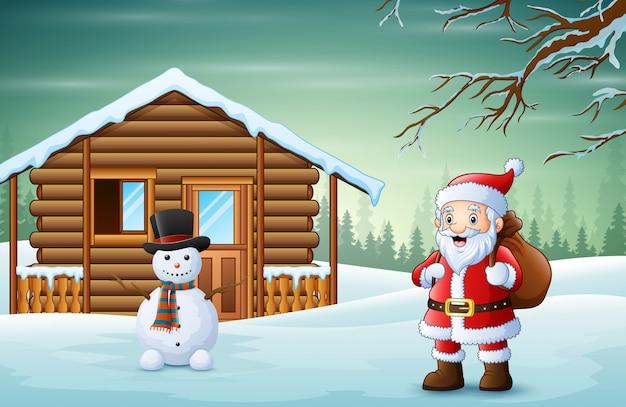贈り物の袋と雪に覆われた村のサンタクロース