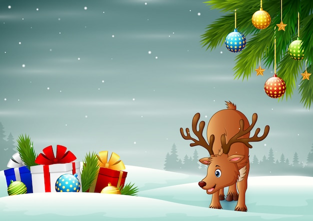 Мультяшный олень возле подарочной коробки в снегу