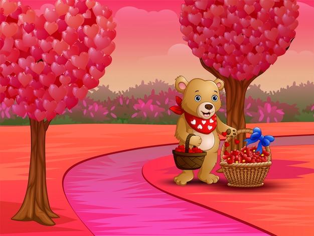 ピンクの自然の中で赤いハートのバスケットと漫画のクマ
