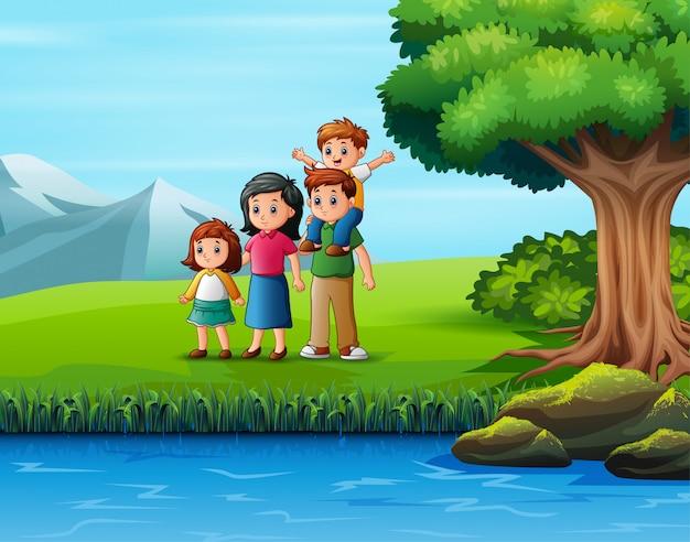 屋外の自然の景色を楽しみながら幸せな家族