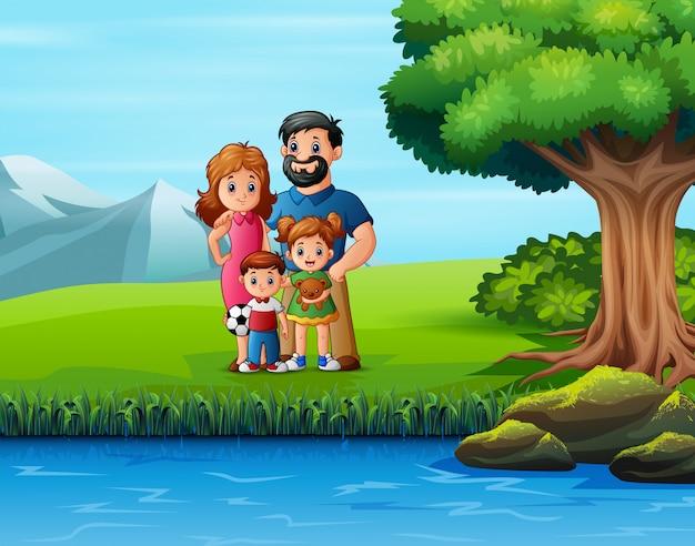 緑豊かな公園で幸せな家族の週末