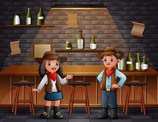 Африканский мальчик и девочка в ковбойской одежде в баре