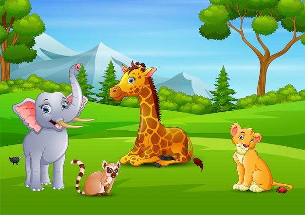 緑の野原で楽しんでいる野生動物漫画