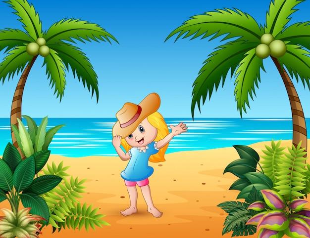 海辺に広い帽子で笑っている美しい女の子