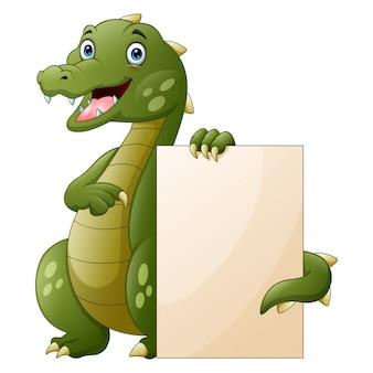 Крокодил мультяшный держит пустой знак на белом фоне