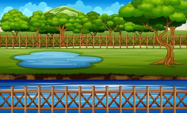 公園の周りの木製のフェンスと背景シーン