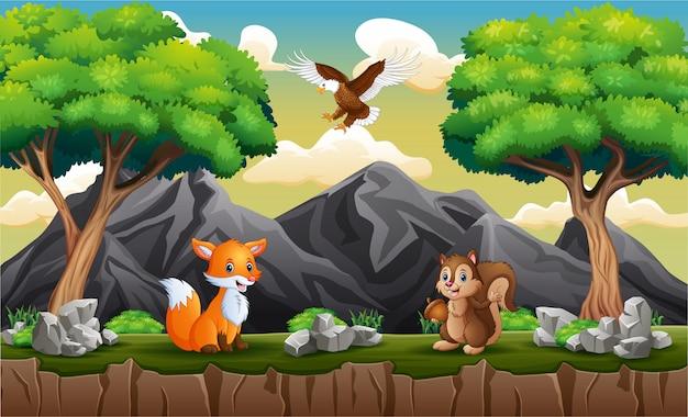 Разные животные играют на холме