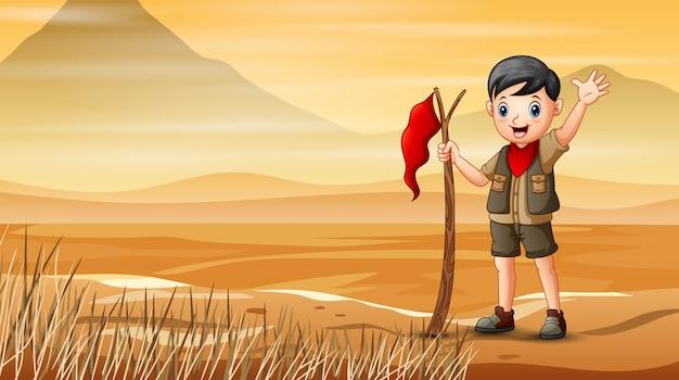 乾燥した土地でハイキングスカウト少年