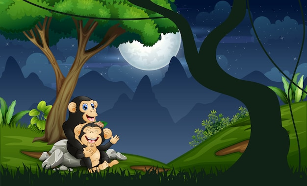 Мать шимпанзе с ребенком в ночном лесу
