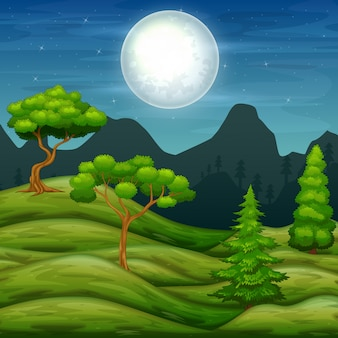 緑の丘の風景と夜の木