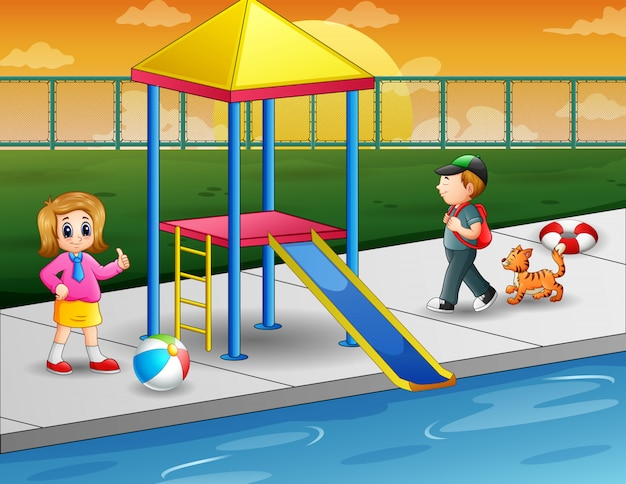 屋外スイミングプールで遊んでいる子供たち