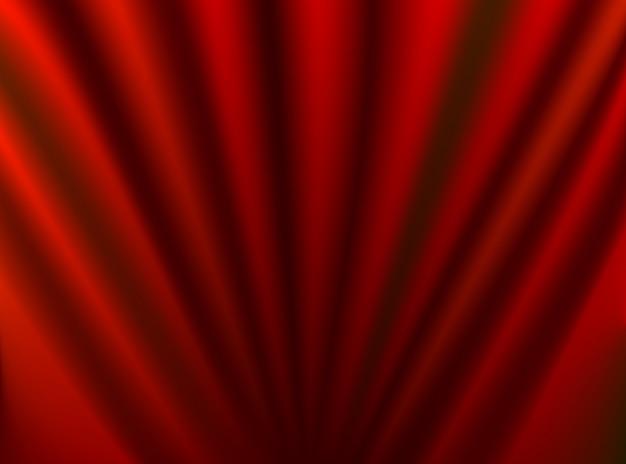 Абстрактный традиционный узор на волнистой гладкой красной шелковой ткани фоне занавеса