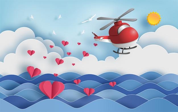 多くの心が浮かんでいる空中を飛んでいるヘリコプター。