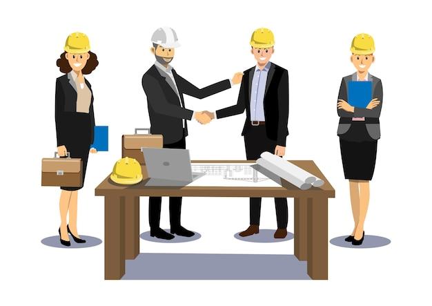 エンジニアとビジネスマンは手を振っている。