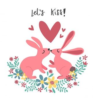 カップルピンクのウサギのウサギの花の花輪でキス