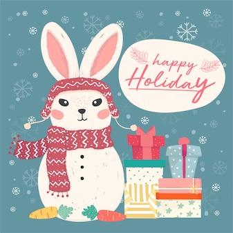 幸せな休日のグリーティングカード。かわいいフラットベクトルバニー雪だるまのギフトボックスと落ちる雪片の山