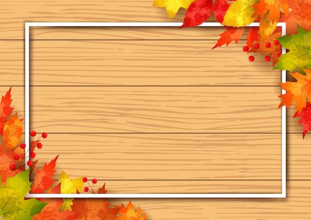 木製の背景と秋の販売フレーム