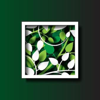 白いフレームの紙のカットの背景とトロピカルグリーンの葉。
