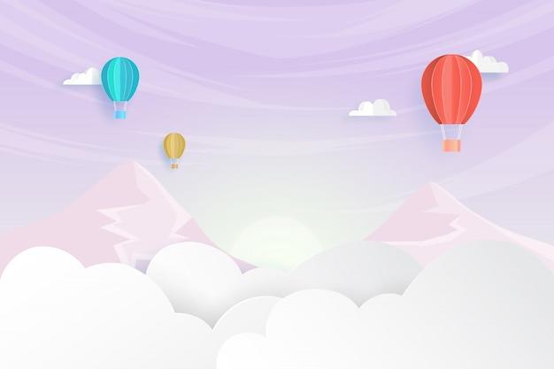 美しい空のペーパーアートスタイルの背景に浮かぶカラフルな熱気球
