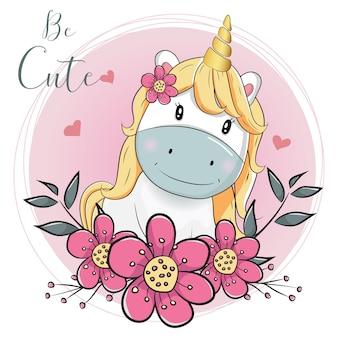 ピンクの背景と花のかわいい漫画のユニコーン