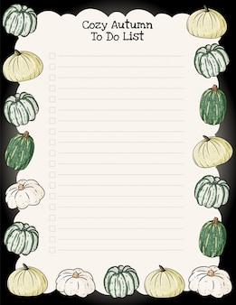 居心地の良い秋のウィークリープランナーとトレンディなカボチャの飾りのリストを行う